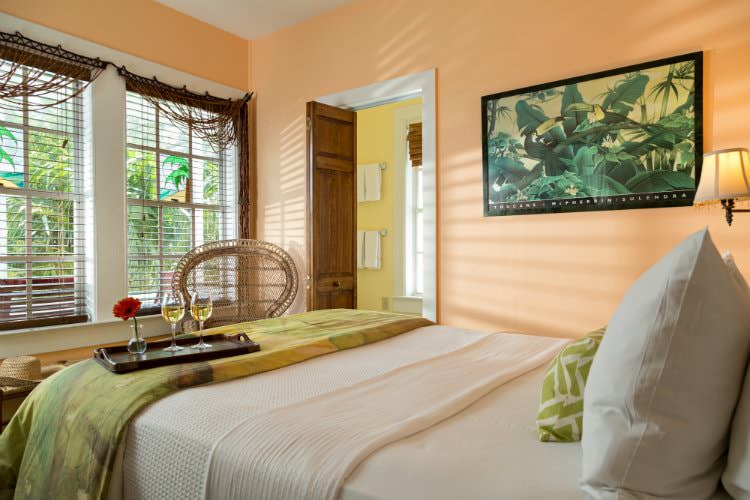 Peach room with panda painting on wall facing windows with mini blinds and connecting yellow bathroom